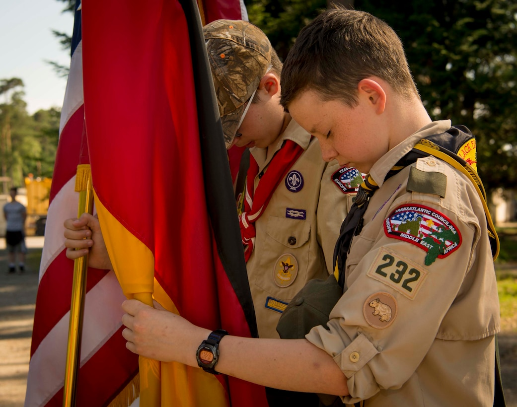 Children of Ramstein personnel who are members of the Boy Scouts of America bow their heads in respect during the invocation at a Flag Day flag disposal ceremony on Ramstein Air Base, Germany, June 14, 2017. Flag Day commemorates the day the U.S. adopted its flag, June 14, 1777. The disposal ceremony, conducted to give proper respect to flags during their disposal, invited participants and audiences to take a moment of appreciation for the pride and heritage the U.S. flag carries. (U.S. Air Force photo by Senior Airman Elizabeth Baker.)