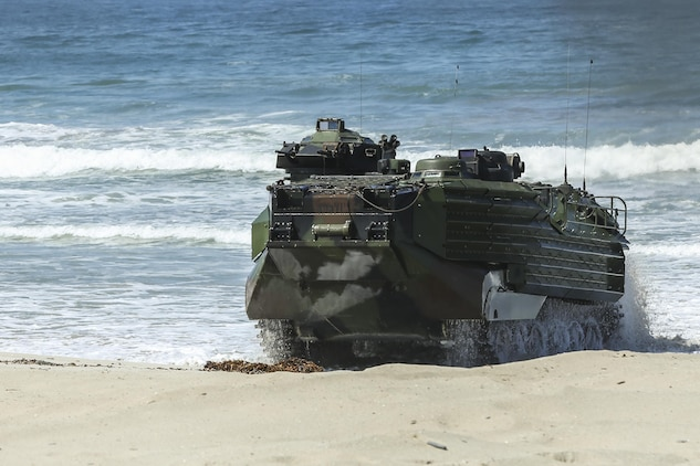 An Assault Amphibious Vehicle, with 15th Marine Expeditionary Unit, lands on Red Beach during the Marine Air- Ground Task Force demonstration for the 75th Anniversary on Camp Pendleton, Calif., June 14, 2017. The demonstration allowed civilians to observe Marines as they recertified their qualifications before deployment. (U. S. Marine Corps photo by Lance Cpl. Betzabeth Y. Galvan)