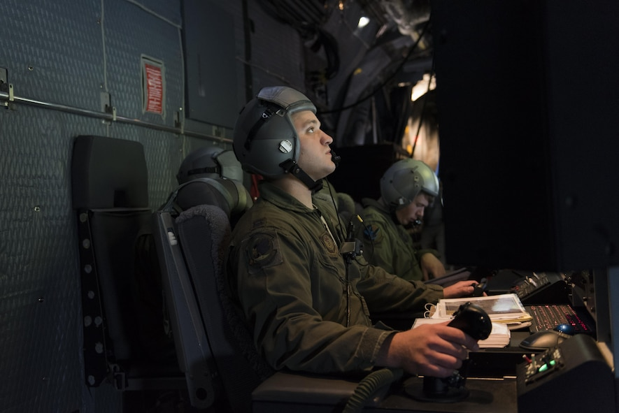 Capt. Brian Burt, 16th Special Operations Squadron combat systems officer, observes the situation on the ground through multiple screens at the mission operators pallet aboard an AC-130W Stinger II at Cannon Air Force Base, New Mexico, June 13, 2017. At the MOP, Burt can operate the 30mm and 105mm guns on the aircraft. (U.S. Air Force photo by Staff Sgt. Michael Washburn/Released)