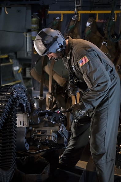 Staff Sgt. Tyler Nelson, 551st Special Operations Squadron aerial gunner, works on the 30mm gun aboard an AC-130W Stinger II at Cannon Air Force Base, New Mexico, June 13, 2017. The guns on the aircraft are controlled by a mission operator's pallet and the aerial gunners are there to fix problems with the weapons in they arise. (U.S. Air Force photo by Staff Sgt. Michael Washburn/Released)
