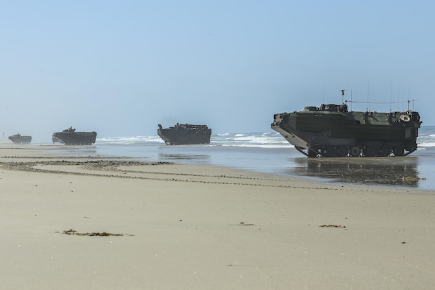 Assault Amphibious Vehicles, with 15th Marine Expeditionary Unit, lined up in formation on Red Beach during the Marine Air- Ground Task Force demonstration for the 75th Anniversary on Camp Pendleton, Calif., June 14, 2017. The demonstration allowed civilians to observe Marines as they recertified their qualifications before deployment. (U. S. Marine Corps photo by Lance Cpl. Betzabeth Y. Galvan)