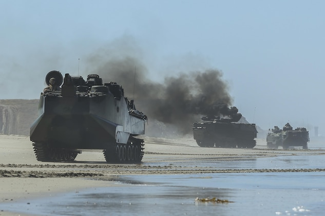 An Assault Amphibious Vehicle, with 15th Marine Expeditionary Unit, departs from Red Beach during the Marine Air- Ground Task Force demonstration for the 75th Anniversary on Camp Pendleton, Calif., June 14, 2017. The demonstration allowed civilians to observe Marines as they recertified their qualifications before deployment. (U. S. Marine Corps photo by Lance Cpl. Betzabeth Y. Galvan)
