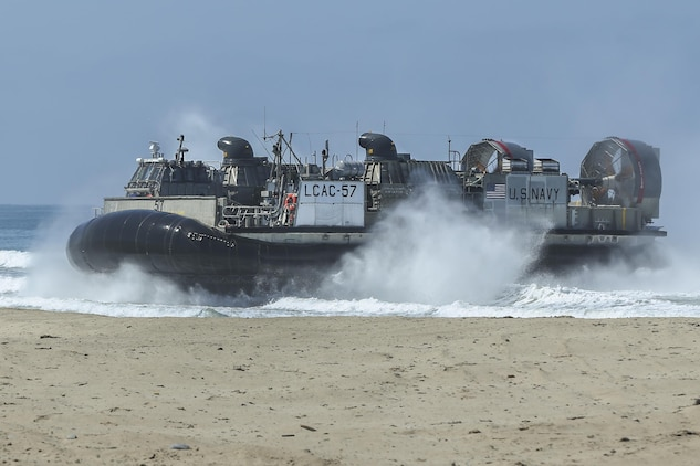 A Landing Craft Air Cushion, with 15th Marine Expeditionary Unit, lands at Red Beach during the Marine Air- Ground Task Force demonstration for the 75th Anniversary on Camp Pendleton, Calif., June 14, 2017. The demonstration allowed civilians to observe Marines as they recertified their qualifications before deployment. (U. S. Marine Corps photo by Lance Cpl. Betzabeth Y. Galvan)