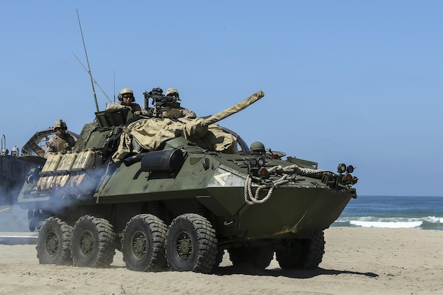 A Light Armored Vehicle, with 15th Marine Expeditionary Unit, moves to the static display area for the guests to view at Red Beach during the Marine Air- Ground Task Force demonstration for the 75th Anniversary on Camp Pendleton, Calif., June 14, 2017. The demonstration allowed civilians to observe Marines as they recertified their qualifications before deployment. (U. S. Marine Corps photo by Lance Cpl. Betzabeth Y. Galvan)