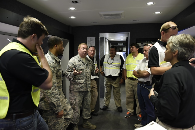 U.S. Air Force Tech. Sgt. Mark Fow an emergency manager for the 145th Airlift Wing briefs officers of the Tennessee Valley Authority on the functions and utility of the Mobile Emergency Operations Center while at Fontana Dam North Carolina, June 10, 2017. Vigilant Catamount is a multi-day exercise testing emergency response, with Fontana Dam being the subject of a bomb threat requiring action by the National Guard and local authorities to include the Tennessee Valley Authority. The Mobile Emergency Operations Center is run by the 145th Airlift Wing and provides a self-sufficient mobile power, and communications network on the go.