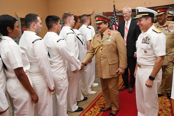 Hamad bin Isa Al Khalifa, the King of the Kingdom of Bahrain, shakes hands with Sailors during a visit to discuss operations in the U.S. 5th Fleet area of operations and coalition operations to defeat ISIS. The King was accompanied by two of his sons, His Highness Brig. Gen. Shaikh Nasser bin Hamad Al Khalifa, commander of the Royal Guard, and His Highness Maj. Shaikh Khaled bin Hamad Al Khalifa, commander of the Royal Guard Special Force; the commander-in-chief of the Bahrain Defense Force, His Excellency Field Marshal Shaikh Khalifa bin Ahmed Al Khalifa; and the commander of the Bahraini Royal Navy, His Excellency Rear Adm. Shaikh Khalifa bin Abdullah Al Khalifa. Bahrain has been a partner with the United States in regional maritime security for nearly 70 years. (U.S. Navy photo by Mass Communication Specialist 2nd Class Victoria Kinney/Released)