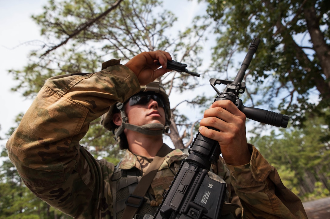 Sgt. Michael Hughes, with the 2nd Battalion, 377th Infantry Regiment, 95th Division, 108th Training Command, fixes his front sight post before zeroing his M4 rifle, at the 2017 U.S. Army Reserve Best Warrior Competition at Fort Bragg, N.C., June 13. This year's Best Warrior Competition will determine the top noncommissioned officer and junior enlisted Soldier who will represent the U.S. Army Reserve in the Department of the Army Best Warrior Competition later this year at Fort A.P. Hill, Va. (U.S. Army Reserve photo by Lisa Velazco) (Released)