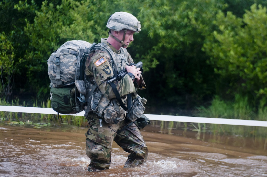 A Warrior marches through water at the 2017 U.S. Army Reserve Best Warrior Competition at Fort Bragg, N.C. June 13. This year's Best Warrior Competition will determine the top noncommissioned officer and junior enlisted Soldier who will represent the U.S. Army Reserve in the Department of the Army Best Warrior Competition later this year at Fort A.P. Hill, Va. (U.S. Army Reserve photo by Trenton Fouche) (Released)