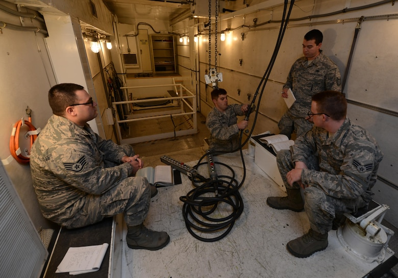 Members of the 91st Missile Maintenance Squadron missile maintenance team inspect a hoist at Minot Air Force Base, N.D., May 30, 2017. The five-member Global Strike Challenge 2017 maintenance team inspected payload transporter hoists to ensure they can properly lift missile components. (U.S. Air Force photo/Airman 1st Class Jonathan McElderry)