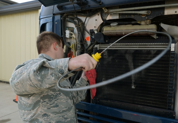Senior Airman Damien White, 91st Missile Maintenance Squadron missile maintenance team member, inspects a vehicle's engine oil at Minot Air Force Base, N.D., May 30, 2017. These Airmen performed fuel-water separator inspections to help prepare for Global Strike Challenge 2017. (U.S. Air Force photo/Airman 1st Class Jonathan McElderry)