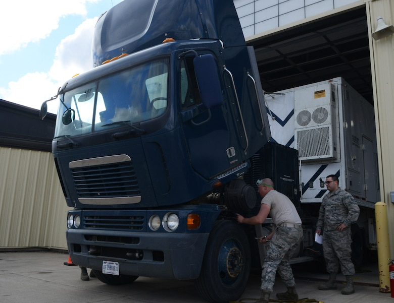 Members of the 91st Missile Maintenance Squadron missile maintenance team inspect a payload transporter at Minot Air Force Base, N.D., May 30, 2017. Global Strike Challenge MMT members check a vehicle's engine, break fluids, fuel-water separators and several other components during each inspection. (U.S. Air Force photo/Airman 1st Class Jonathan McElderry)