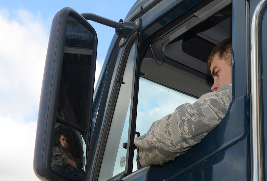 Senior Airman Damien White, 91st Missile Maintenance Squadron missile maintenance team member, performs a vehicle break check at Minot Air Force Base, N.D., May 30, 2017. The missile maintenance team performed payload transporter maintenance in preparation for Global Strike Challenge 2017. (U.S. Air Force photo/Airman 1st Class Jonathan McElderry)