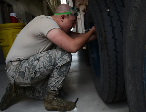 Senior Airman Allen Farmer, 91st Missile Maintenance Squadron missile maintenance team member, checks a tire's air pressure at Minot Air Force Base, N.D., May 30, 2017. The missile maintenance team performed payload transporter inspections to help them train for Global Strike Challenge 2017. (U.S. Air Force photo/Airman 1st Class Jonathan McElderry)