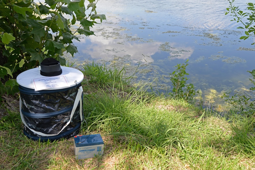 A mosquito trap, set by the Medical Operations Squadron Public Health Office, sits by the pond at Leaning Pines Golf Course at Laughlin Air Force Base, June 14, 2017.  The mosquito traps are used to test the insects for the Zika Virus, and should not be moved or touched. (U.S. Air Force photo/Airman 1st Class Daniel Hambor)