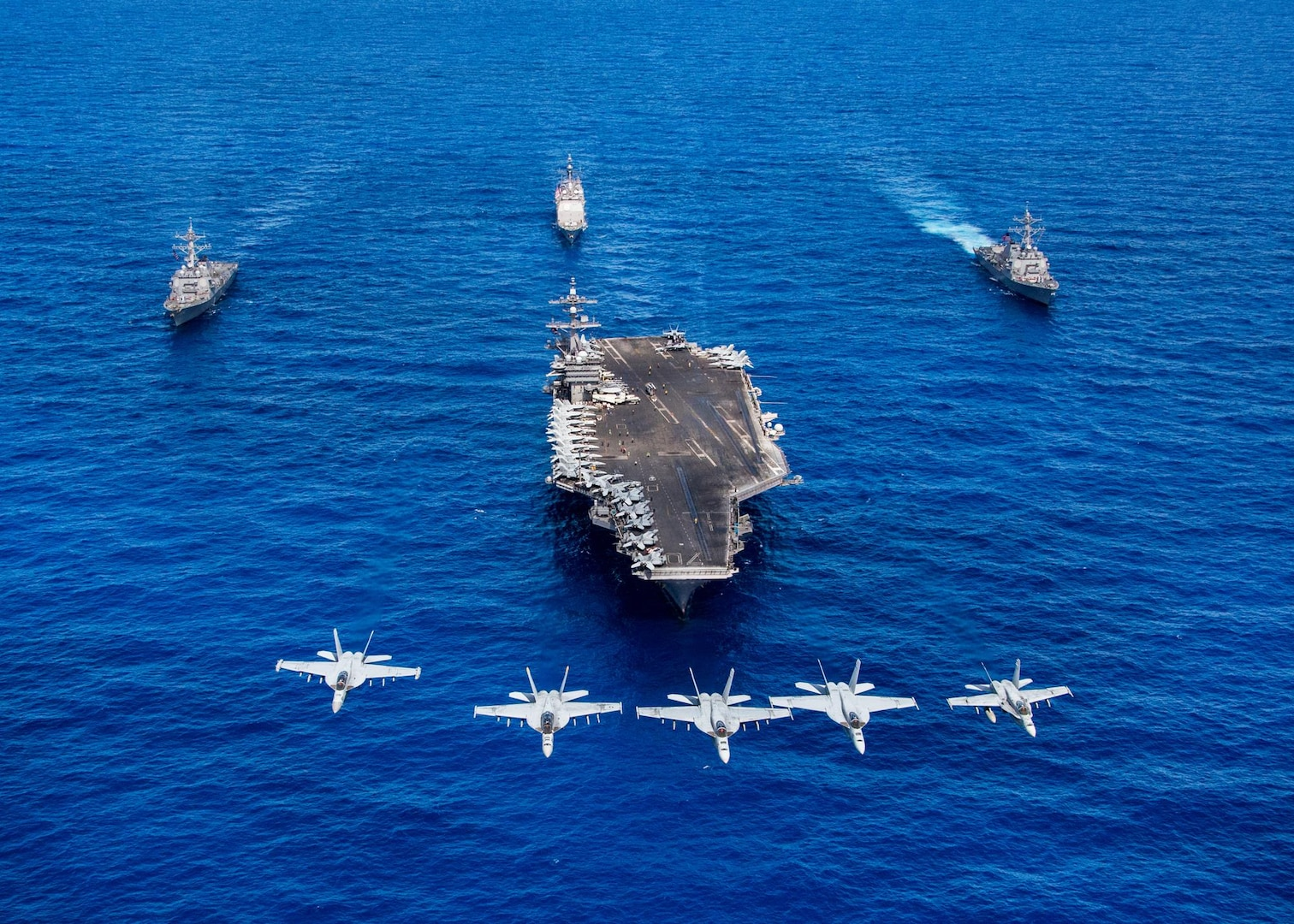 F/A-18 Hornets and Super Hornets from Carrier Air Wing (CVW) Two fly over Nimitz-class aircraft carrier USS Carl Vinson (CVN 70), front, Arleigh Burke-class guided-missile destroyers USS Wayne E. Meyer (DDG 108), right, and USS Michael Murphy (DDG 112), left, and Ticonderoga-class guided-missile cruiser USS Lake Champlain (CG 57) transit the Pacific Ocean, June 12, 2017. The U.S. Navy has patrolled the Indo-Asia-Pacific routinely for more than 70 years promoting regional peace and security.