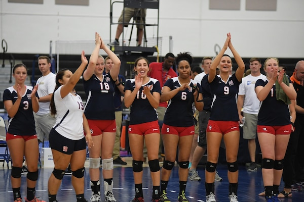 USA celebrates their victory over the Netherlands in match 8 of the 18th Conseil International du Sport Militaire (CISM) World Women's Volleyball Military Championship on 7 June 2017 at Naval Station Mayport, Florida. USA will face China in the finals here at the Mayport Fitness Center on June 9th. (Photo by Petty Officer Timothy Schumaker, NPASE Southeast)