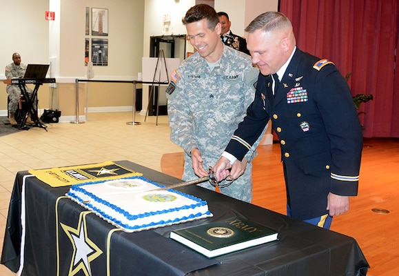 Defense Logistics Agency Aviation's Col. Mark Hirschinger, chief, Army Customer Facing Division, Customer Operations Directorate, cuts the Army birthday cake June 13, 2017 with Sgt. Tom Katsiyiannis, 392nd Army Band, Fort Lee, Virginia, at Defense Supply Center Richmond, Virginia. The cake ceremony is a long standing Army tradition where the soldier with longest time in service cuts the cake with the soldier with the least amount of time in service using the ceremonial military saber.