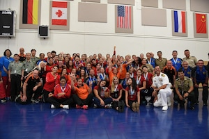 Teams gather after the closing ceremony of the 18th Conseil International du Sport Militaire (CISM) World Women's Volleyball Military Championship on 9 June 2017 at Naval Station Mayport, Florida.
