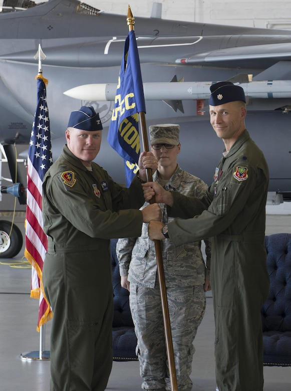 Lt Col. Gary Marlowe(Right) relinquishes command of the 389th Fighter Squadron to 366 Operations Group Commander Col Brian McCarthy May 22, 2017, at Mountain Home Air Force Base, Idaho. Marlowe and the T-Bolts recently returned from a successful deployment to southeast asia. (U.S. Air Force photo by Airman 1st Class Jeremy D. Wolff/Released)
