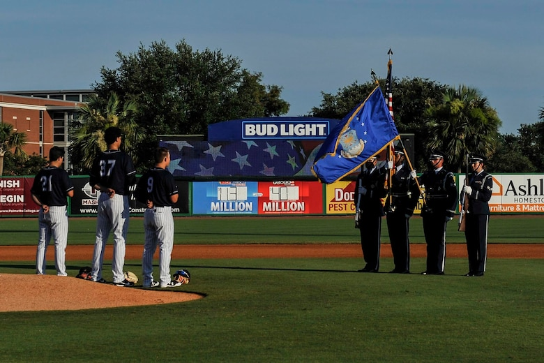 The Joint Base Charleston Honor Guard post the colors during the Charleston RiverDogs Military Appreciation Night at Joseph P. Riley Jr. Park, Charleston, June 14, 2017. The 841st Transportation Battalion, 628th Security Forces Squadron and 628th Civil Engineer Squadron Explosive Ordnance Disposal Flight represented JB Charleston at the game. The RiverDogs beat the West Virginia Power 5-2.