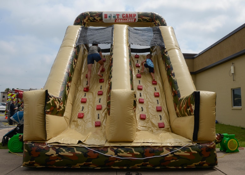 Healthy Lifestyle Festival attendees take on the obstacle course at Laughlin Air Force Base, June 13, 2017. The obstacle course, provided by the 47th Force Support Squadron, gave parents a chance to let their children exercise during the festival. (U.S. Air Force photo/ Airman 1st Class Benjamin N. Valmoja)