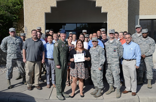 "Ms. Yamilka Pinero-Medina, 47th Civil Engineering Squadron Energy Manager, was chosen by wing leadership to be this week's ""XLer,"" June 6, 2017. The ""XLer"" award is presented by Col. Thomas Shank, 47th Flying Training Wing commander, and is given to those who consistently make outstanding contributions to their unit, Laughlin and the flying training mission. (U.S. Air Force photo/Airman 1st Class Daniel Hambor)"