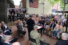 Maj. Gen. Troy D. Kok, commanding general of the U.S. Army Reserve's 99th Regional Support Command, speaks June 14 at a naturalization ceremony at the Betsy Ross House in downtown Philadelphia. Thirteen individuals became U.S. citizens in an event that coincided with Flag Day and the 242nd Army birthday.