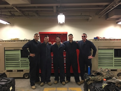 From Left to Right: 1stSgt Joe Mendez, Capt Joe Zukowski, Capt Ed Elizondo, Capt Jack Mades, Maj Reagan King. Company Commanders get their hands dirty and aid in the Preventative Maintenance and Corrective Service (PMCS) of tactical vehicles within the Battalion.