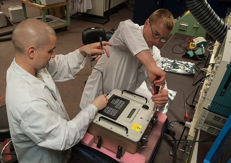 (From left) Staff Sgt. Dustin Stetler and Tech. Sgt. Maxie Cardinal, 791st Maintenance Squadron electronics laboratory technicians, assemble a circuitry test set at Minot Air Force Base, N.D., May 31, 2017. During training, the maintenance team inspected and tested various components of a circuitry test set to prepare for Global Strike Challenge 2017. (U.S. Air Force photo/Airman 1st Class Jonathan McElderry)