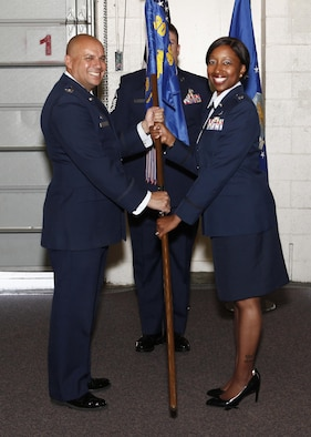 Col. Frank Verdugo, 90th Mission Support Group commander, passes the guidon to Lt. Col. Erin O. Weatherly, 90th Civil Engineer Squadron commander, during the 90th CES change-of-command ceremony June 15, 2017, as Master Sgt. Jeremy Britten, 90th CES first sergeant, stands in the background in the Tech Sgt. Matthew Schwartz Explosive Ordnance Disposal Facility on F.E. Warren Air Force Base, Wyo. The ceremony signified the transition of command from Lt. Col Robert C. Lance to Weatherly.  (U.S. Air Force photo by Lan Kim)