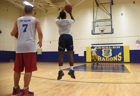 Airman 1st Class Emante Jackson, 81st Surgical Operations Squadron surgical technician, shoots a basketball as 2nd Lt. Johnny Inlavon, 333rd Training Squadron student, waits for his turn during a basketball knockout competition in the Blake Fitness Center June 12, 2017, on Keesler Air Force Base, Miss. The competition was one of several Wingman Week events focusing on resiliency and teambuilding initiatives across the base. (U.S. Air Force photo by Kemberly Groue)