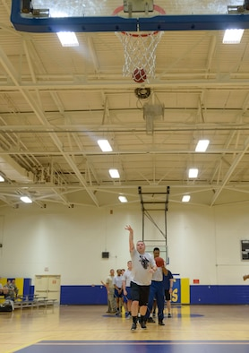 Tech. Sgt. Tristan Carden, 335th Training Squadron instructor supervisor, shoots a three-pointer during a basketball knockout competition in the Blake Fitness Center June 12, 2017, on Keesler Air Force Base, Miss. The competition was one of several Wingman Week events focusing on resiliency and teambuilding initiatives across the base. (U.S. Air Force photo by André Askew)
