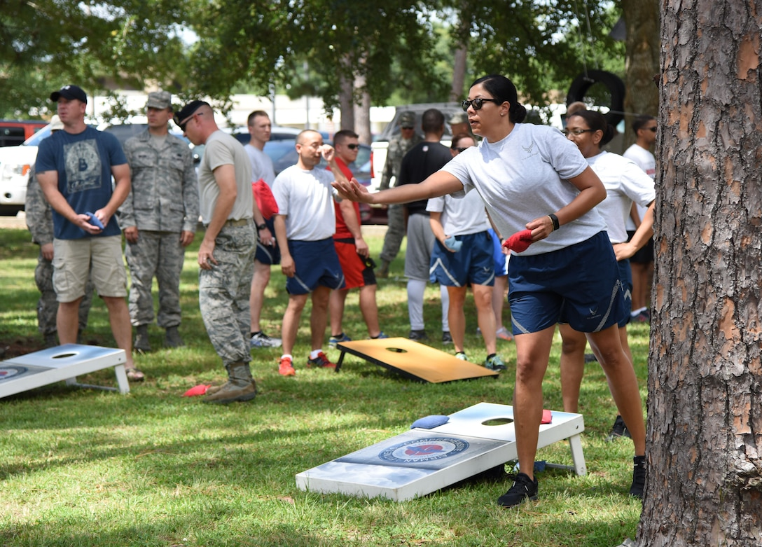 Senior Master Sgt. Melanie Townsend, 81st Comptroller Squadron Wing Staff Agency superintendent, participates in the cornhole competition behind the Blake Fitness Center June 13, 2017, on Keesler Air Force Base, Miss. The competition was one of several Wingman Week events focusing on resiliency and teambuilding initiatives across the base. (U.S. Air Force photo by Kemberly Groue)