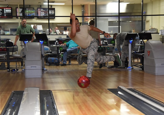 Senior Airman Cameron Spriggs, 81st Logistics Readiness Squadron logistics planner, participates in a bowling competition at Gaudé Lanes June 13, 2017, on Keesler Air Force Base, Miss. The competition was one of several Wingman Week events focusing on resiliency and teambuilding initiatives across the base. (U.S. Air Force photo by Kemberly Groue)