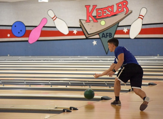 Senior Airman Cecil Whiting, 81st Surgical Operations Squadron medical technician, participates in a bowling competition at Gaudé Lanes June 13, 2017, on Keesler Air Force Base, Miss. The competition was one of several Wingman Week events focusing on resiliency and teambuilding initiatives across the base. (U.S. Air Force photo by Kemberly Groue)