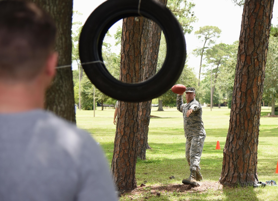 Chief Master Sgt. Derek Fromenthal, 338th Training Squadron superintendent, participates in a football skills competition behind the Blake Fitness Center June 13, 2017, on Keesler Air Force Base, Miss. The competition was one of several Wingman Week events focusing on resiliency and teambuilding initiatives across the base. (U.S. Air Force photo by Kemberly Groue)
