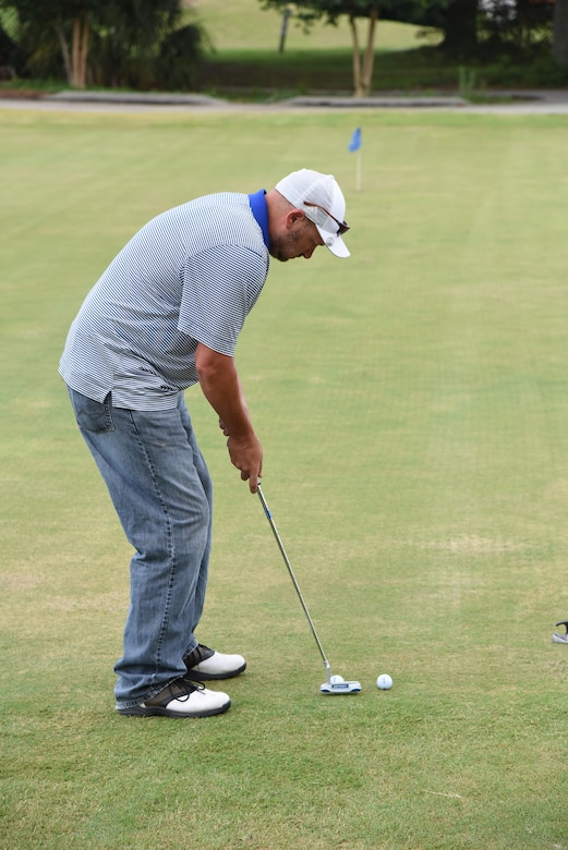 Heath Harris, 81st Training Support Squadron technical engineer, participates in a golf putting competition at the Bay Breeze Golf Course June 14, 2017, on Keesler Air Force Base, Miss. The competition was one of several Wingman Week events focusing on resiliency and teambuilding initiatives across the base. (U.S. Air Force photo by Kemberly Groue)