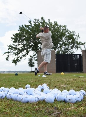Master Sgt. Andrew Eccleston, 81st Diagnostic and Therapeutics Squadron core lab NCO in charge, participates in a long drive competition at the Bay Breeze Golf Course June 14, 2017, on Keesler Air Force Base, Miss. The competition was one of several Wingman Week events focusing on resiliency and teambuilding initiatives across the base. Eccleston won the competition. (U.S. Air Force photo by Kemberly Groue)