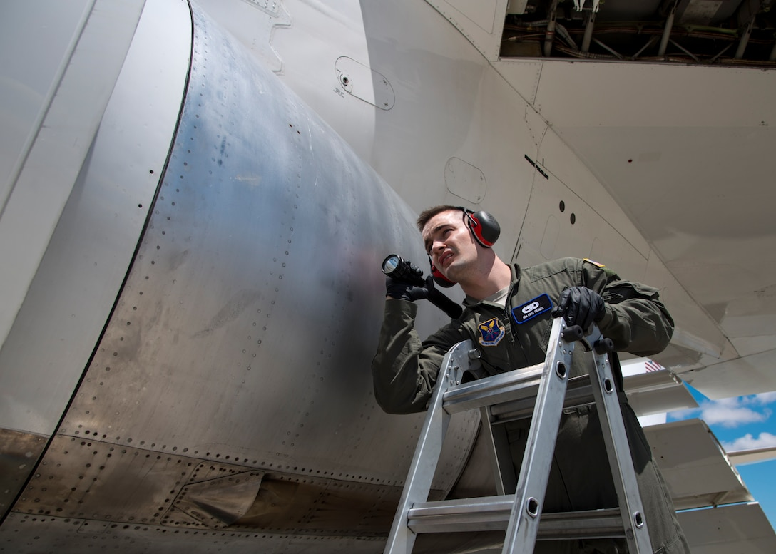 Senior Airman Cody Grauel, 595th Aircraft Maintenance Squadron propulsion journeyman, inspects the engine of an E-4B for any damage or leaks after arriving to Travis Air Force Base, Calif., June 9, 2017. The E-4B, from U.S. Air Force Global Strike Command, Barksdale Air Force Base, La., provides support to the Federal Emergency Management Agency, which provides communications and command center capability to relief efforts following natural disasters, such as hurricanes and earthquakes. (U.S. Air Force photo/Staff Sgt. Nicole Leidholm/Released)