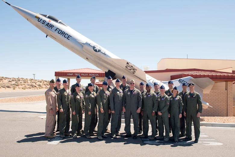 Twenty officers from the Air Force, Navy, Marines, and from Singapore, the United Kingdom and Australia, completed the one year curriculum at the U.S. Air Force Test Pilot School to graduate as Class 16B June 9.