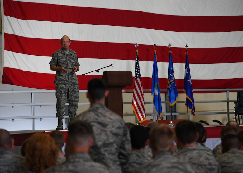 Gen. Mike Holmes, Air Combat commander, responds to a question asked by an officer in the audience during an all-call at Grand Forks Air Force Base, N.D., June 15, 2017. Holmes opened up the floor during the all-call, allowing Airmen to ask questions about the recent transition of the 319th Air Base wing from Air Mobility Command, to Air Combat Command. (U.S. Air Force photo by Airman 1st Class Elora McCutcheon)