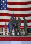 Gen. Mike Holmes, Air Combat commander, right, receives the guidon from Gen. Carlton Everhart, Air Mobility commander, left, during a realignment ceremony at Grand Forks Air Force Base, N.D., June 15, 2017. Passing the guidon symbolizes the change of the 319th Air Base Wing from Air Mobility Command, to Air Combat Command. (U.S. Air Force photo by Airman 1st Class Elora McCutcheon)