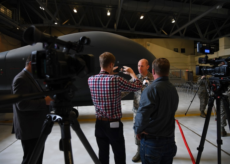 Gen. Mike Holmes, Air Combat Control commander, speaks during an interview with a local news channel, WDAZ News, after a realignment ceremony at Grand Forks Air Force Base, N.D., June 15, 2017. The ceremony marked the first official day of the 319th Air Base Wing's transition from Air Mobility Command to Air Combat Command. (U.S. Air Force photo by Airman 1st Class Elora McCutcheon)
