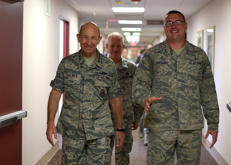 "Tech. Sgt. Thomas Sullivan, 319th Medical Support Squadron laboratory NCO-in-charge, escorts Gen. Mike Holmes, Air Combat Command commander, during a tour of the 319th Medical Group June 15, 2017, on Grand Forks AFB, N.D. Holmes spent the day getting to know how the ""Warriors of the North"" meet the mission. (U.S. Air Force photo by Senior Airman Ryan Sparks)"