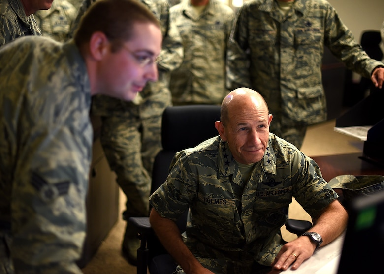 Gen. Mike Holmes, Air Combat Command commander, right, looks on as Senior Airman Nicholas Anthony, 319th Communications Squadron High Frequency Global Communication System radio operator, explains the capabilities of the HFGCS, June 15, 2017, on Grand Forks AFB, N.D. The HFGCS mission is a new asset to ACC and Holmes was able to get a look at how it works. (U.S. Air Force photo by Senior Airman Ryan Sparks)