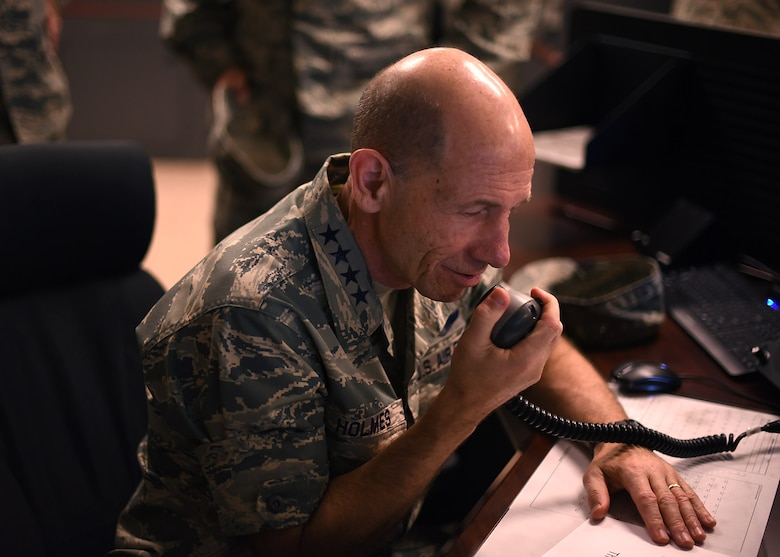 Gen. Mike Holmes, Air Combat Command commander, makes a test call using the High Frequency Global Communication System radio June 15, 2017, on Grand Forks AFB, N.D. Holmes was coined by the 319th Communications Squadron HFGCS unit for making his first official call which broadcasts his voice simultaneously across the world. (U.S. Air Force photo by Senior Airman Ryan Sparks)