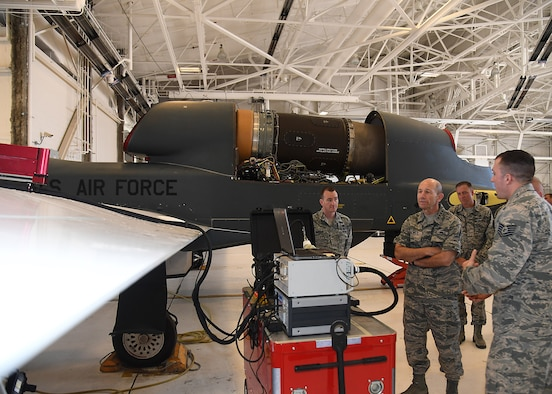 Gen. Mike Holmes, Air Combat Command commander, watches a Mobile Automated Scanner demonstration June 15, 2017, on Grand Forks AFB, N.D. Members of the 69th Maintenance Group were the first Airmen to complete this type of scan on the RQ-4 Global Hawk. (U.S. Air Force photo by Senior Airman Ryan Sparks)