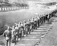 Recruits on the firing line at the .45 pistol range. Camp Matthews, October 1950.