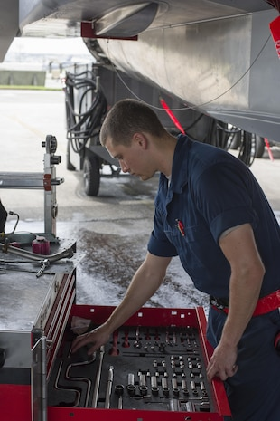 U.S. Air Force Airman 1st Class Andrew Tarnutzer, 67th Aircraft Maintenance Unit F-15 Eagle assistant dedicated crew chief, retrieves tools during maintenance June 13, 2017, at Kadena Air Base, Japan. The 67th AMU maintains the aircraft of one of the largest fighter wings in the U.S. Air Force. (U.S. Air Force photo by Senior Airman Omari Bernard)