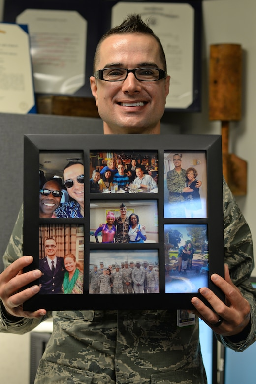 U.S. Air Force Capt. Jason Gordon, 36th Medical Operation Squadron mental health specialist and Andersen Air Force Base Pride Month coordinator, holds up a picture frame featuring his husband, his family and his time in the Navy June 15, 2017, at Andersen AFB, Guam. Gordon joined the armed forces when the Don't Ask, Don't Tell act was still enforced and got to see the change in the military after it was repealed. Gordon coordinated events to recognize Pride Month such as a color run, a paint and sip evening and a mixer and informational booth at the Freedom Fest scheduled for the end of the month. (U.S. Air Force photo by Senior Airman Alexa Ann Henderson)